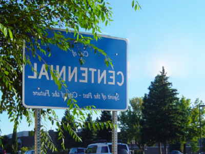 Centennial road sign