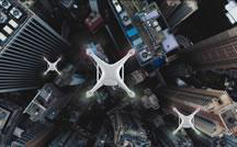 Drones hover over a city