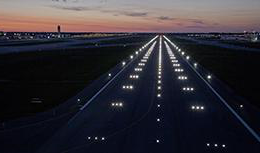 LED lights illuminate the new runway at night in Columbus