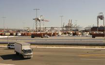 Truck in port lot, with Port of Los Angeles visible in distance