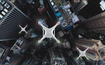 Drones fly over cityscape